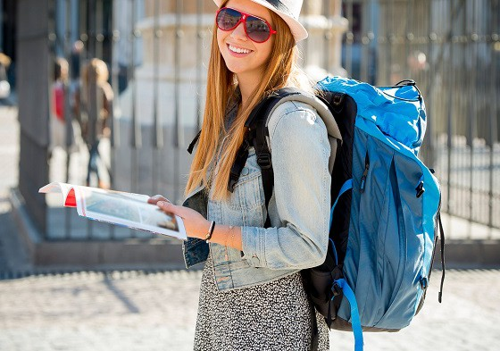 exchange student girl visiting Madrid city reading tourist guide